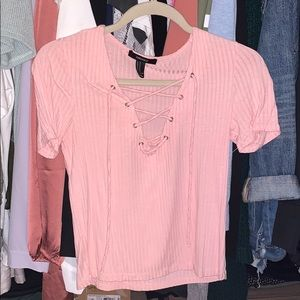 Pink ribbed top with criss cross detailing